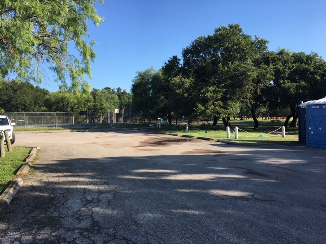 The parking lot is small at Blossom Park in San Antonio.