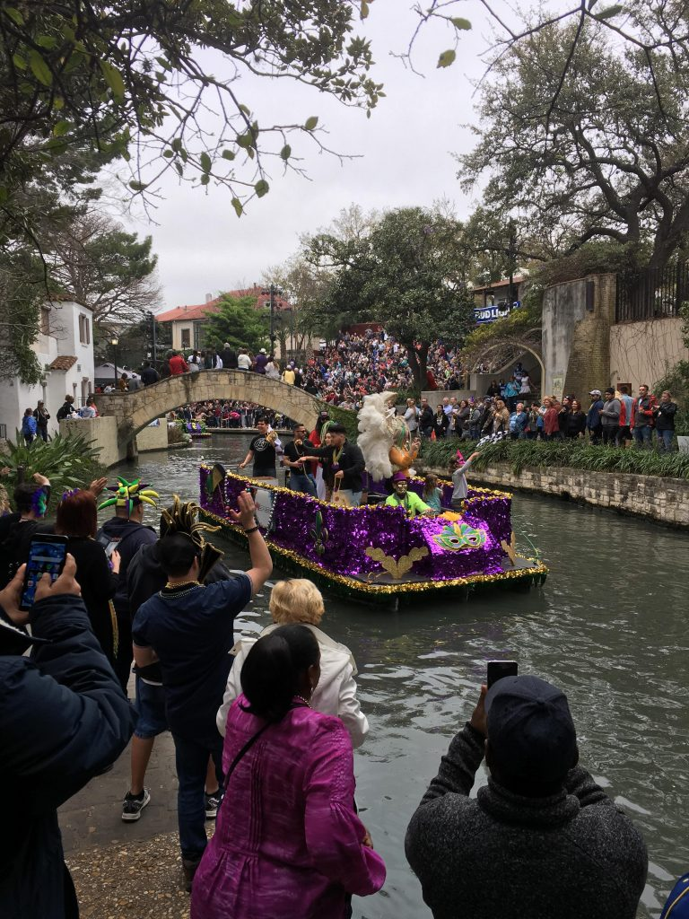 A parade takes place on the San Antonio Riverwalk.