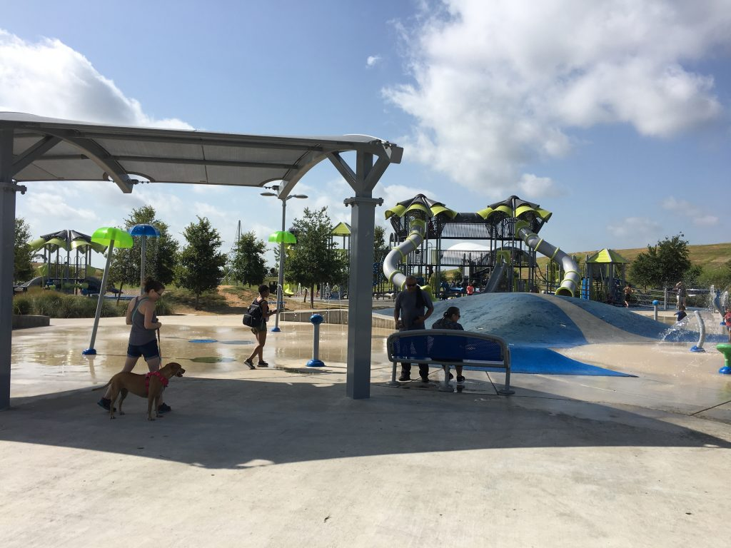 The splash pad and playground at Pearsall Park are great amenities for kids.