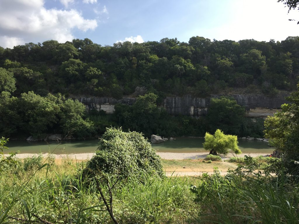 A view of the Guadalupe River and rock cliff from the overlook.
