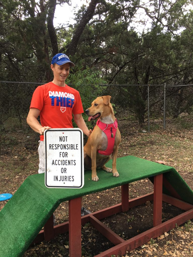 David, and Abbey, pose with a sign found at the Whiskey Bark Park.