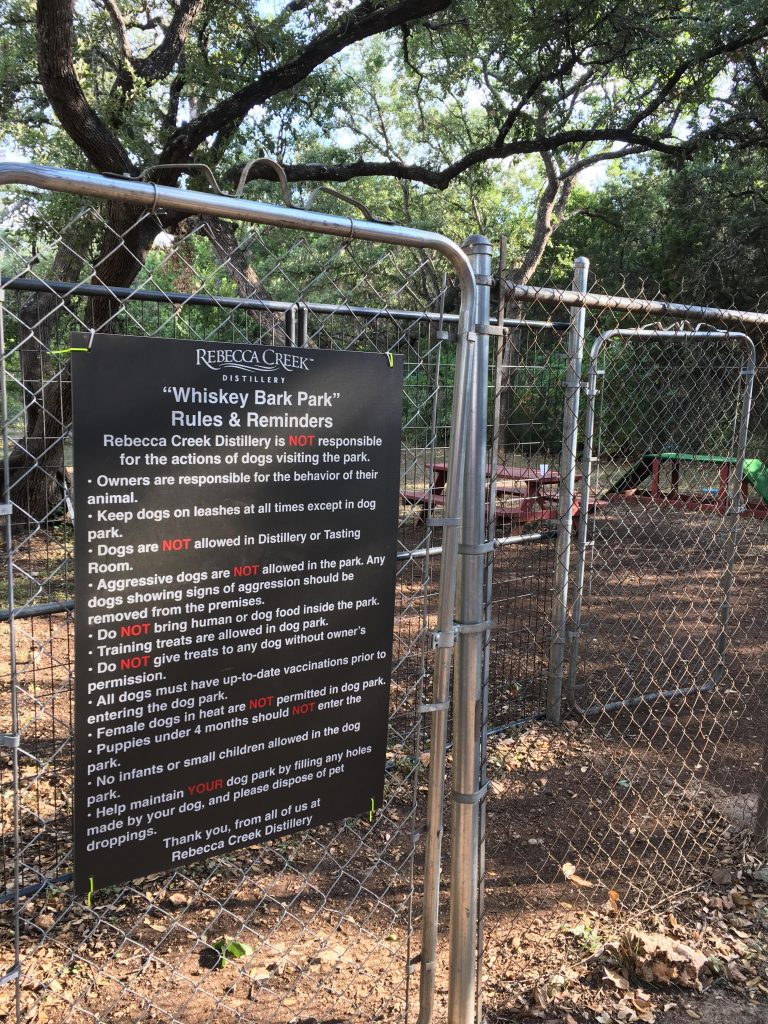 Whiskey Bark Park rules at Rebecca Creek Distillery.