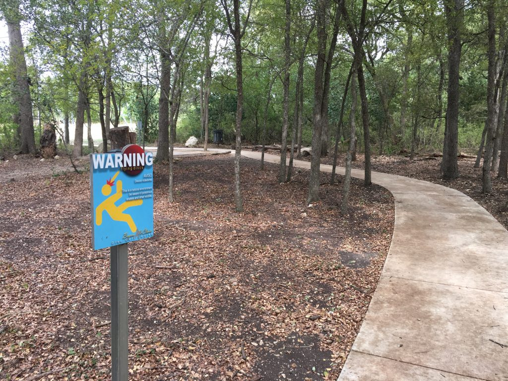 Disc golf in the woods at McClain Park in San Antonio.