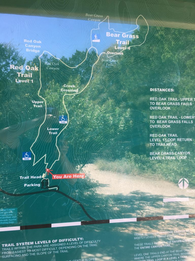 The Crownridge Canyon Park trail map with a reflection of its trail.