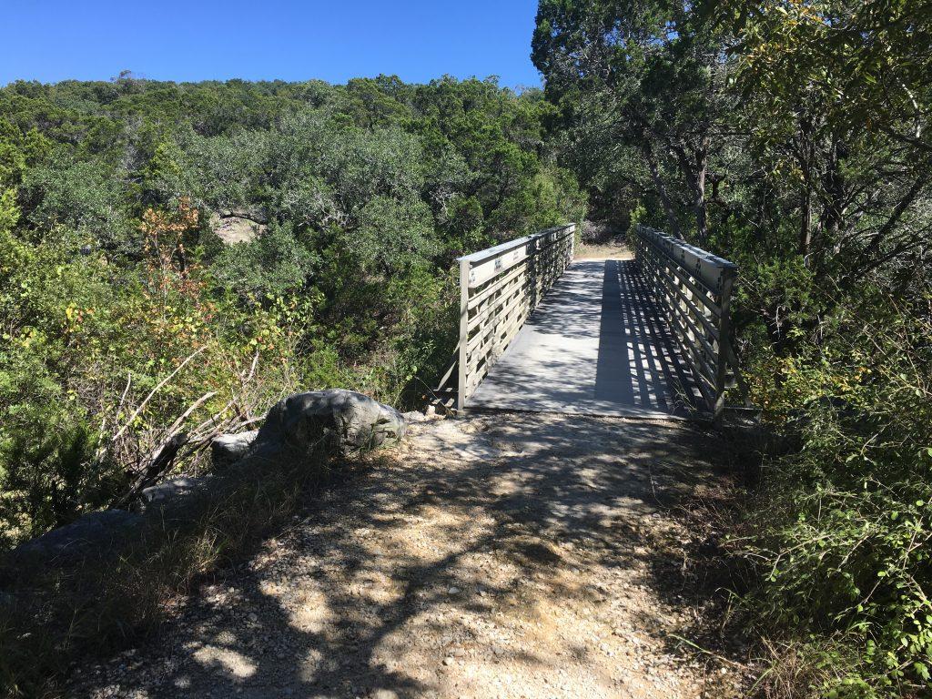 The bridge crossing a canyon at Crownridge Canyon Park.
