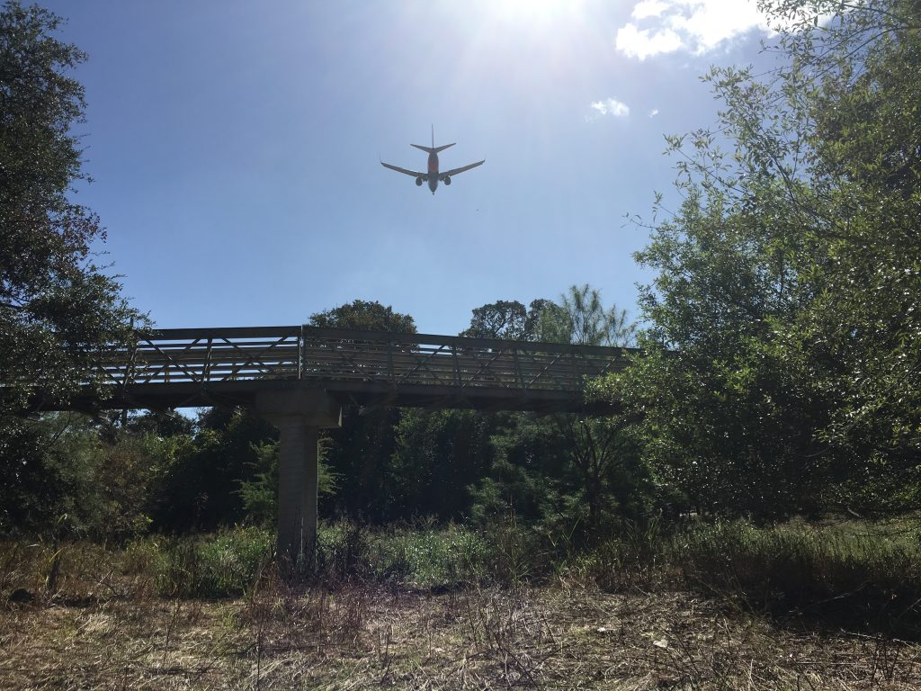 The flight path of San Antonio Airport is directly above the bridge at Walker Ranch Park.