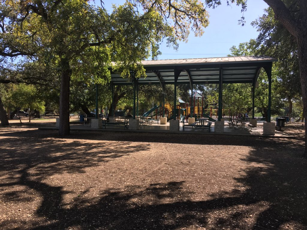 The large pavilion and playground at the park.