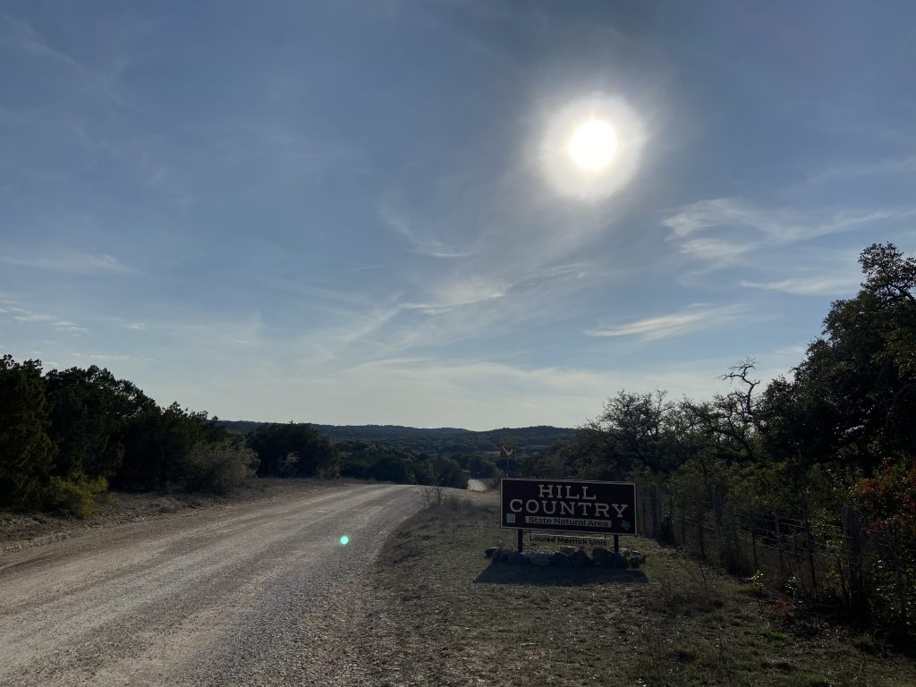 Best hiking in Hill Country State Natural Area, passing the entrance before sunset.
