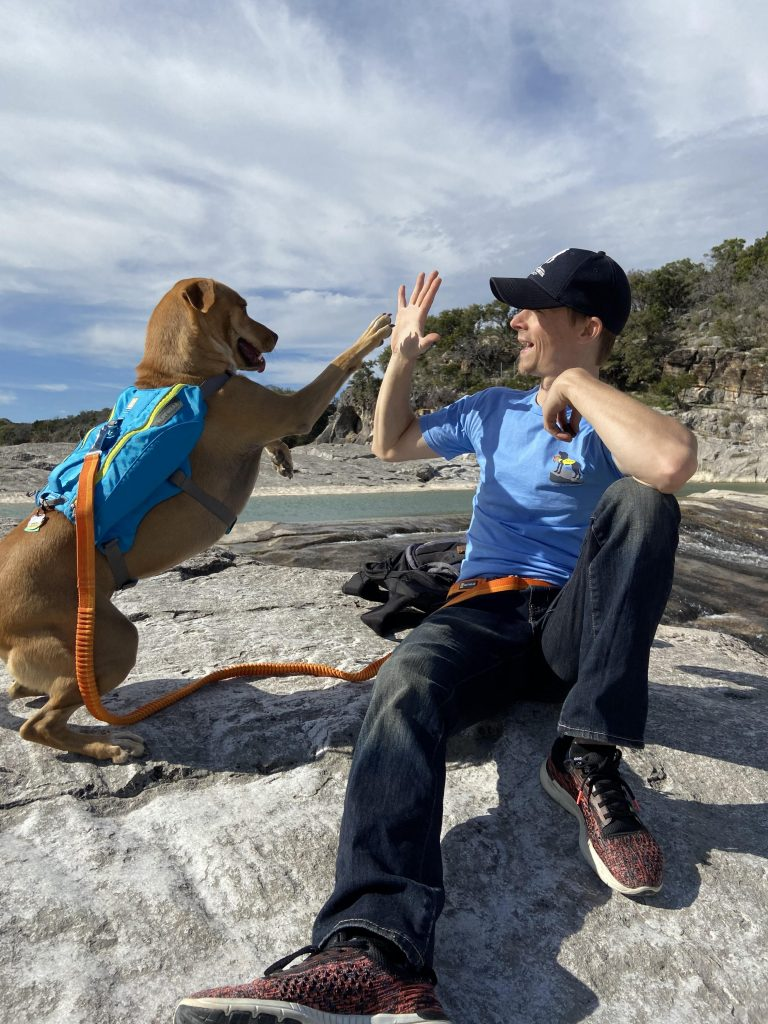 I'm a personal trainer in San Antonio and love to go hiking with my dog. High five at Pedernales Falls.