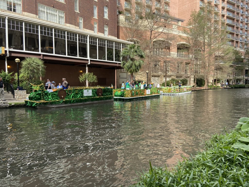 The riverboats were being colored in green on the Riverwalk for St. Patrick's Day.