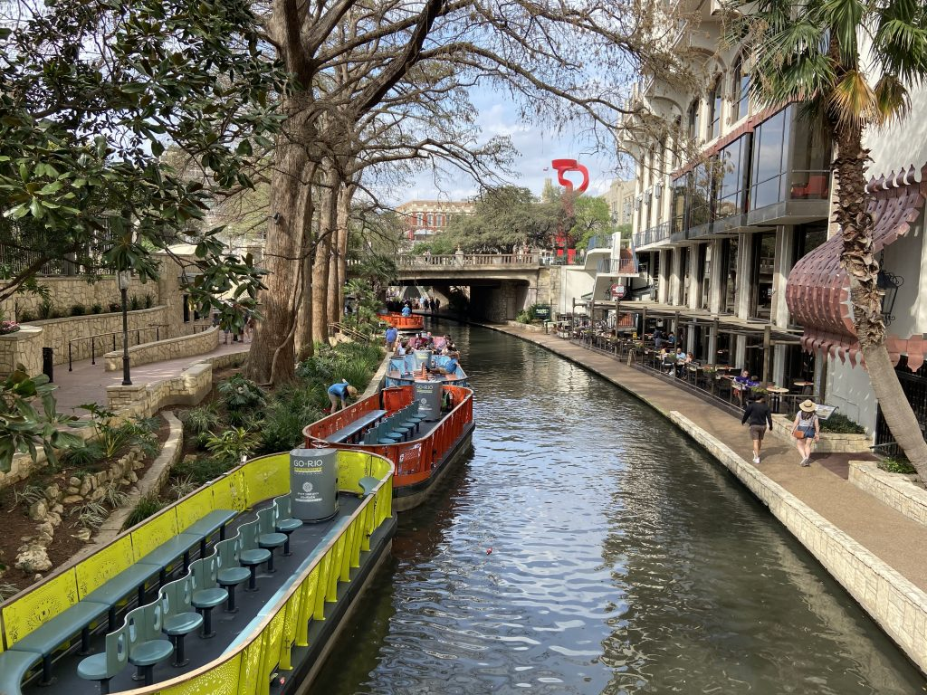 The riverboats along the downtown stretch of the dog friendly San Antonio Riverwalk.