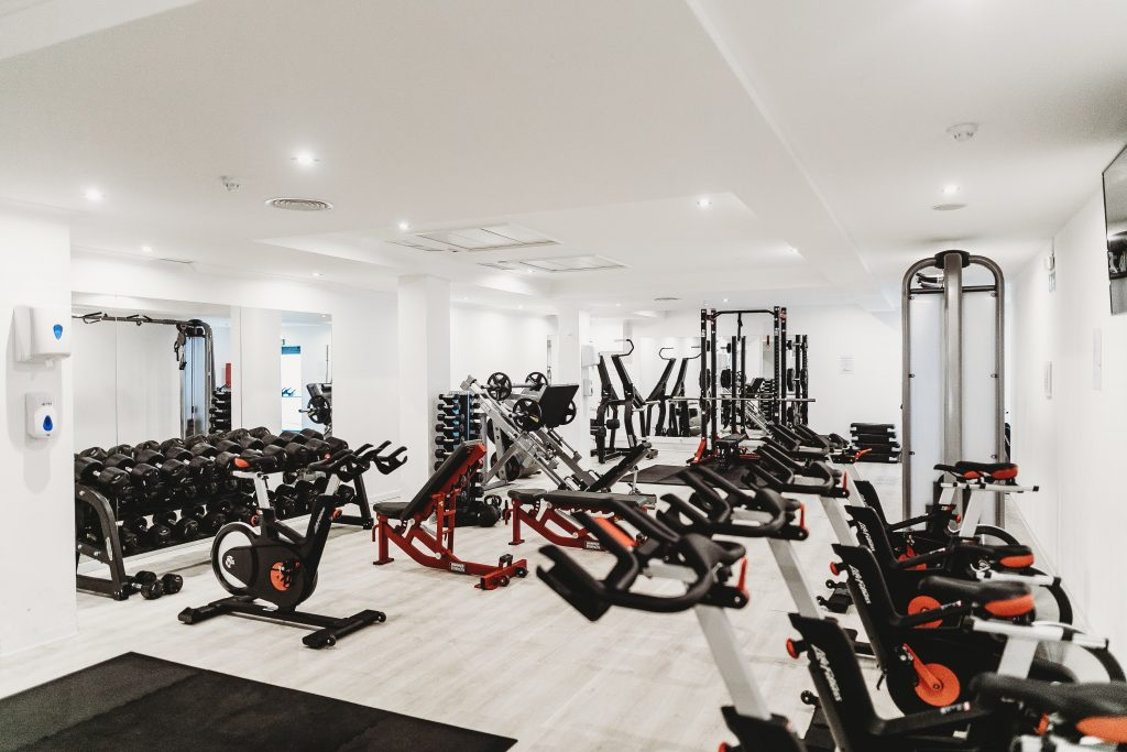 An bright and empty gym will not be a typical sight after you become a personal trainer.