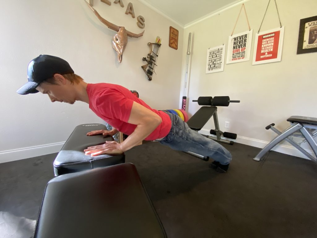 The end position of the low inclined pushup on a weight bench may be more difficult if you can't do push-ups.
