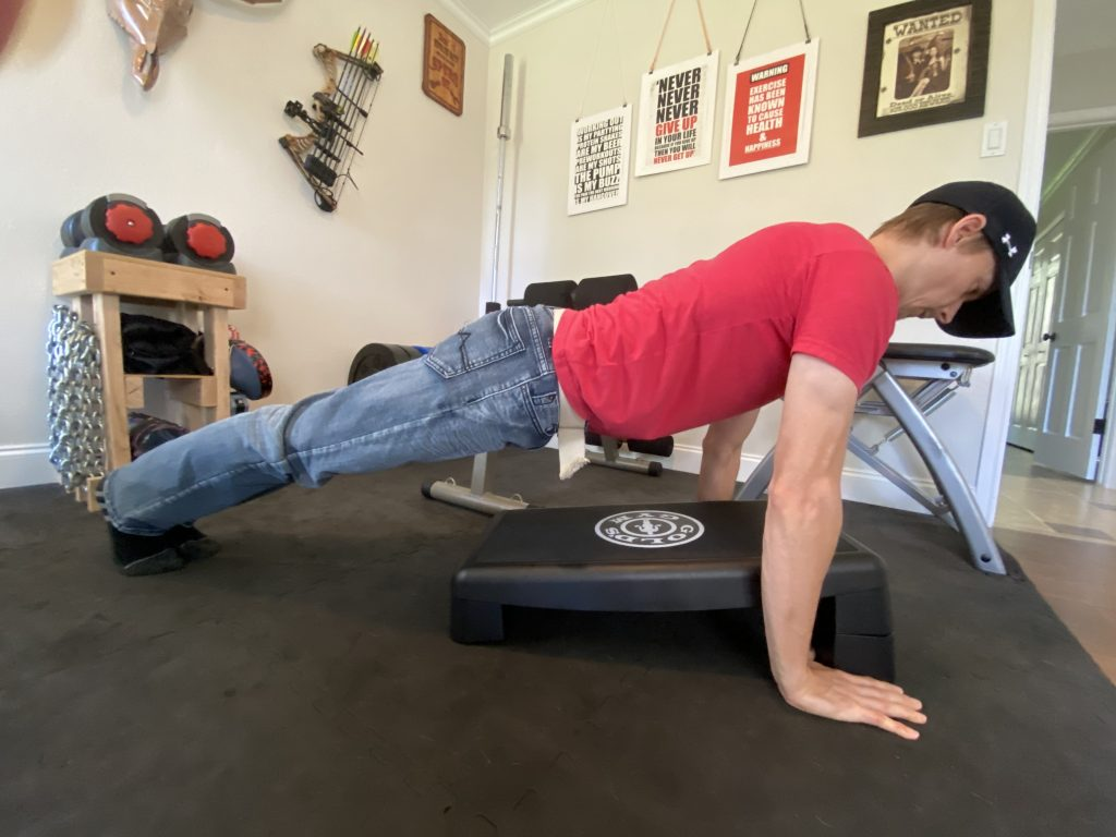 This push-up for beginners uses a platform to reduce the range of motion for those who can't do push-ups.