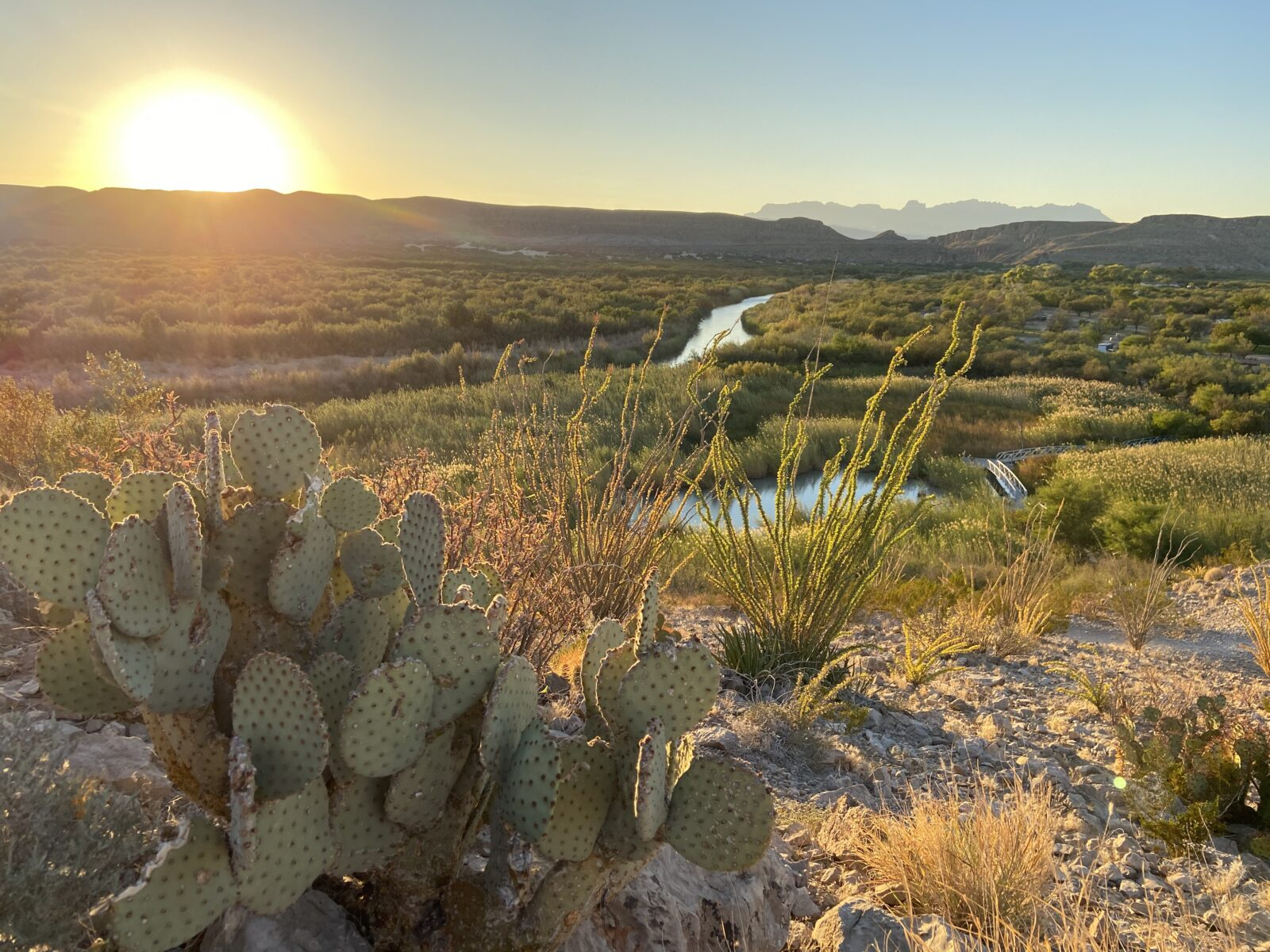 Mountains can be seen in the distance as sun sets on the trail, but you won't find WiFi in Big Bend in this area.