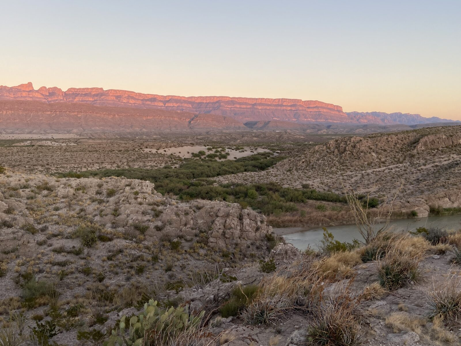 The sun sets on the Sierra Del Carmen Mountains from Big Bend.