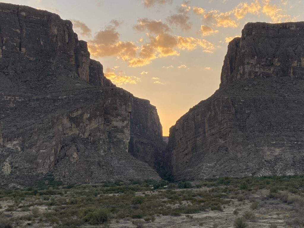 The sun barely shines through the walls at Santa Elena Canyon during sundown inside Big Bend National Park.